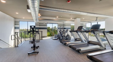 24/7 apartment gym at our apartments near Huntersville, NC