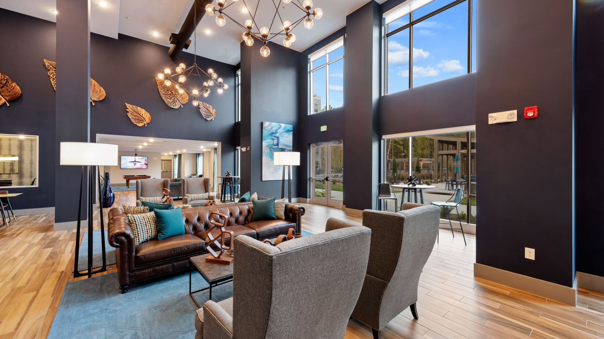 Resident lounge with comfortable chairs and stylish decor at our luxury apartments in Cary, NC