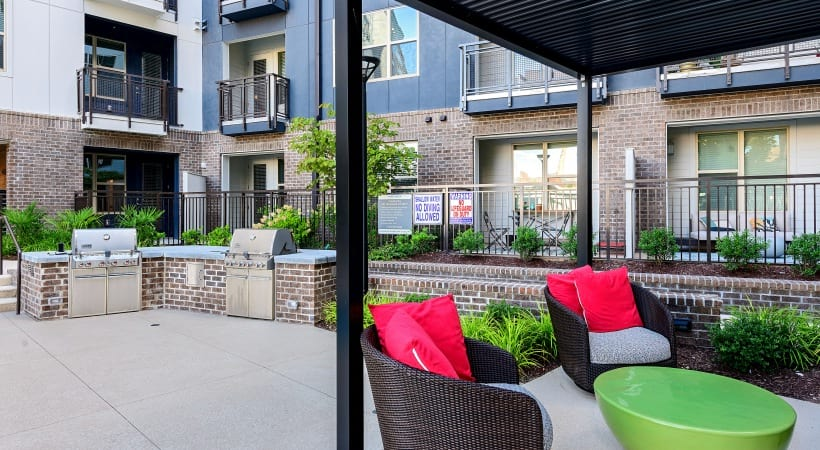 Outdoor kitchen with gas grills at our Downtown Durham apartments