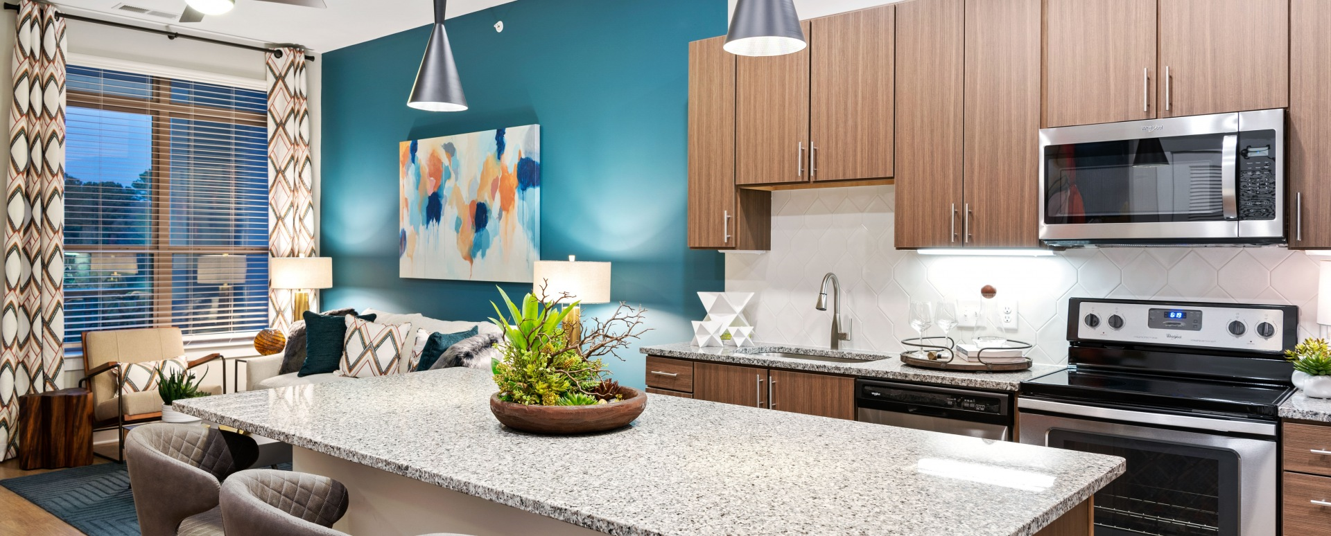Kitchen with granite countertops and designer hardware at our luxury apartments in Cary, NC