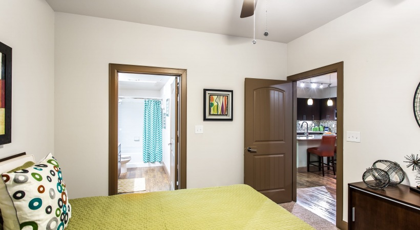 Spacious bedroom with a ceiling fan at our upscale apartments near Legacy West