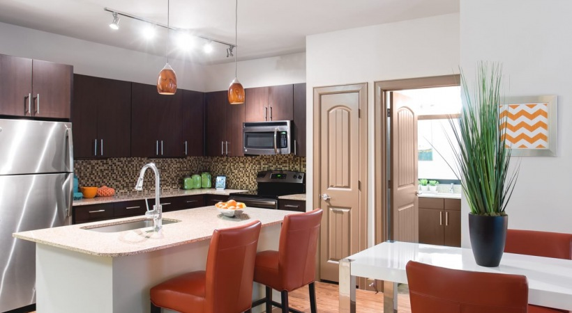 Kitchen and dining room with modern decor at our Stonebiar apartment community
