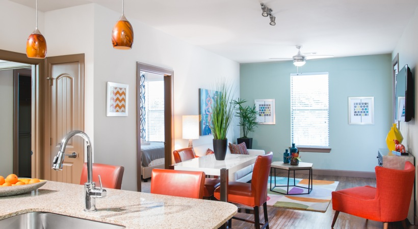 Open-concept kitchen and dining room at our modern apartments near Legacy West
