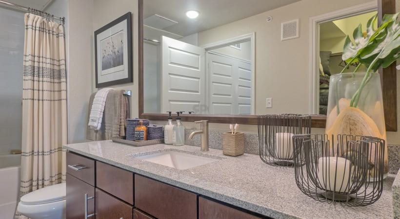Spacious Bathrooms with Granite Countertops