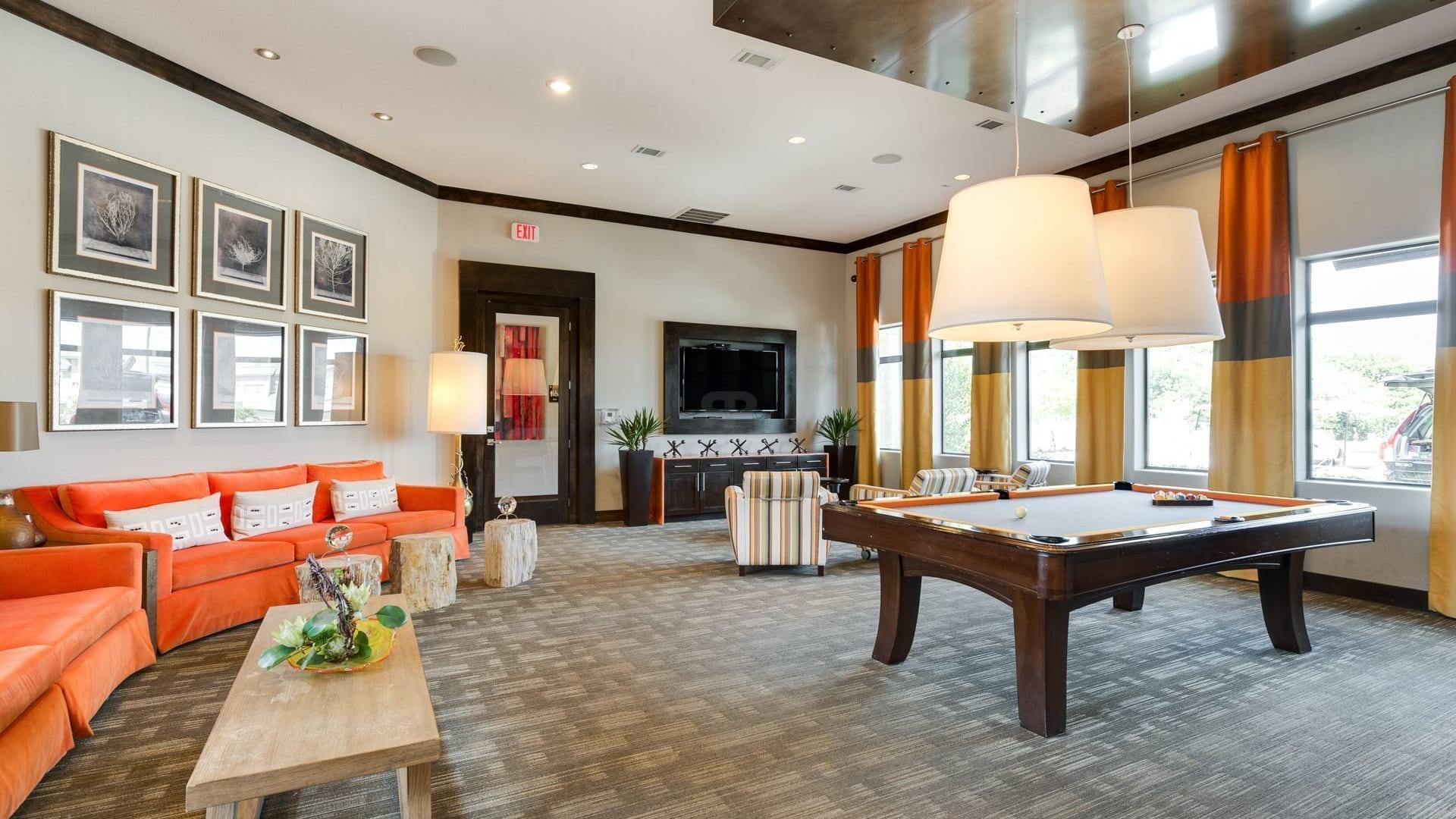 Resident lounge with pool table at Camino Real apartments