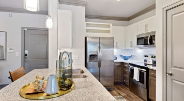 Spacious apartment kitchen with sleek granite countertops