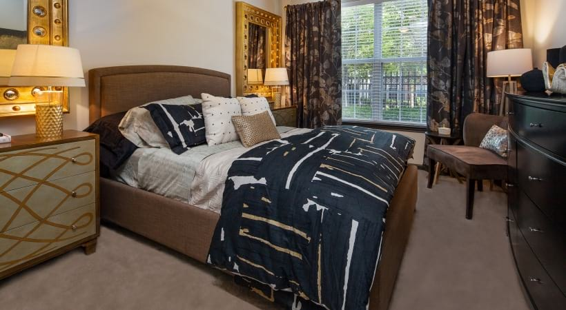 Bedroom with cozy decor at our spacious apartments near Benbrook