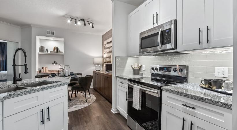 Kitchen with granite countertops at Lansbrook at Twin Creeks