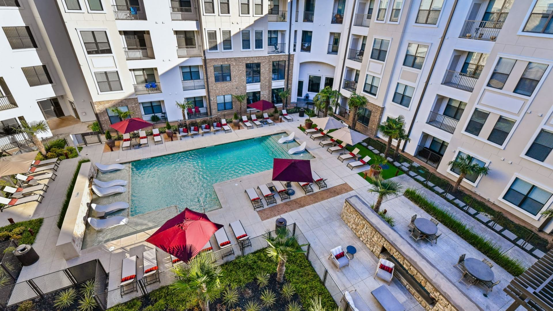 Aerial view of our resort-style pool with sun deck at our apartments near Legacy West