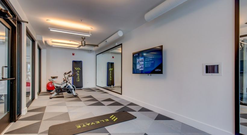 Gym with spin and yoga room at our modern apartements near Denver, CO