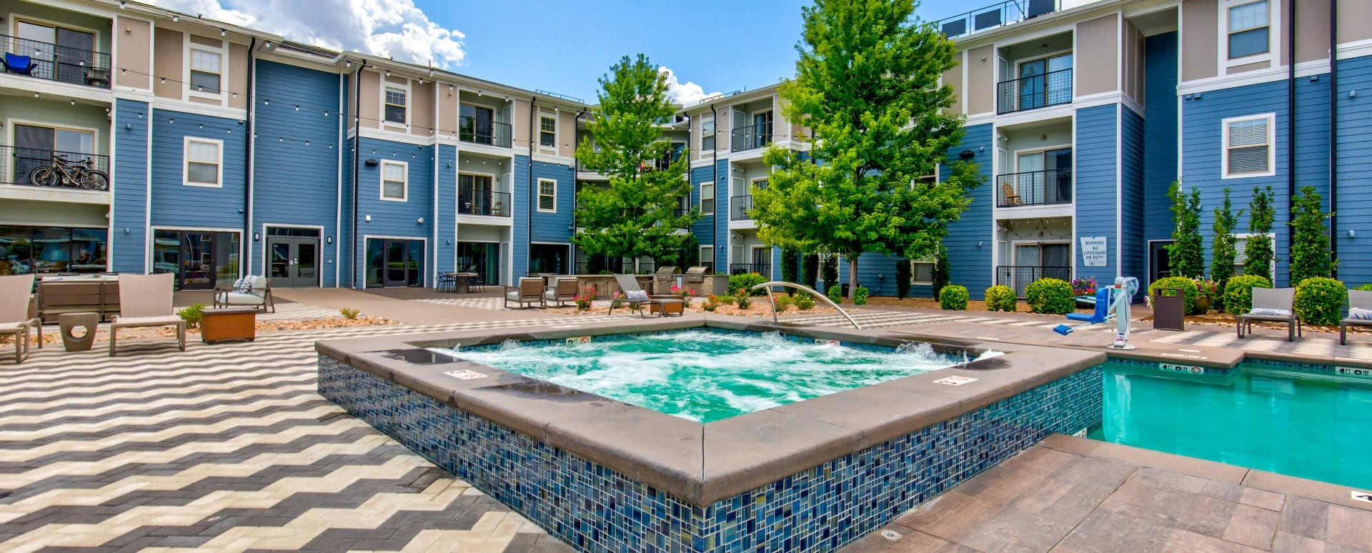 Resort-style pool and spa at our apartments near Denver