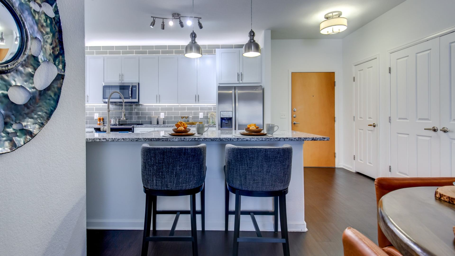 Kitchen with modern lighting at our Highlands Ranch apartments