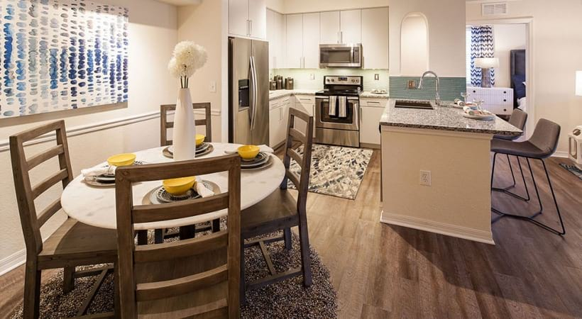 Dining and kitchen area at West Palm apartments for rent