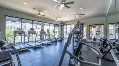 Apartment fitness center at Cortland Seven Meadows