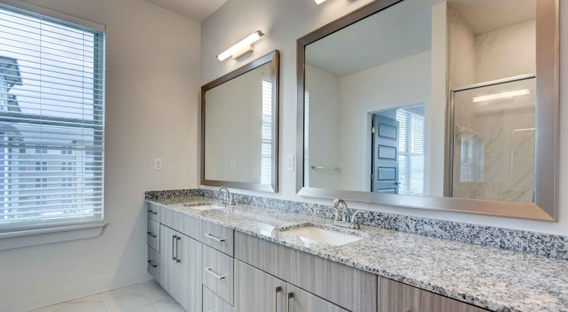 Bathroom with double sink vanities at our spacious apartments in Broomfield