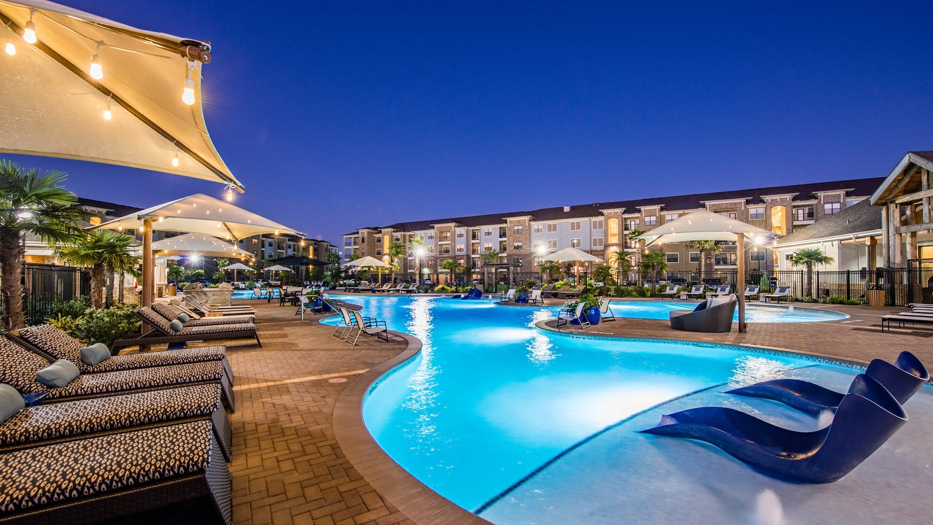 Resort style apartment pool at Cortland Spring Plaza