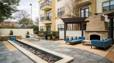Outdoor fireplace at Addison apartments for rent