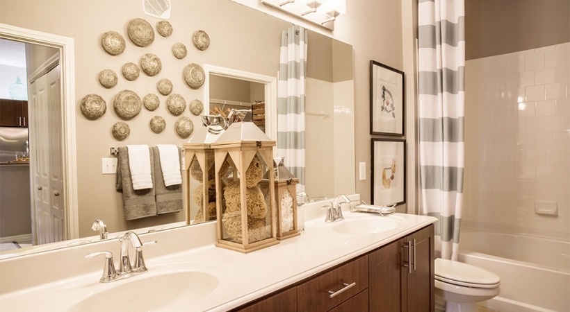 Bathroom with double vanities at Addison Circle apartments