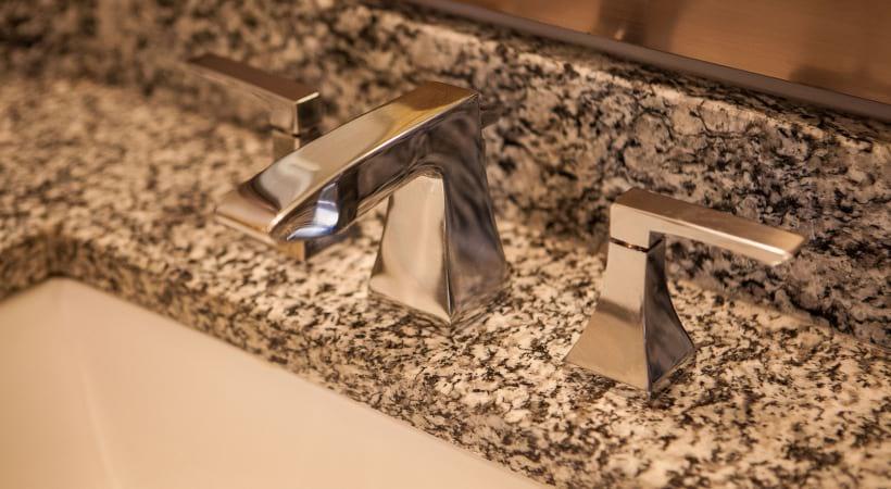 Sleek Granite Countertops in Bathrooms