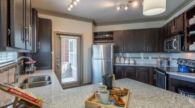 Luxury apartment kitchen with sleek granite countertops