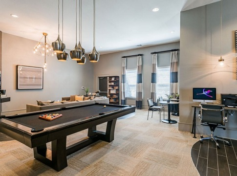 Resident clubhouse with pool table at our Cortland apartments