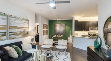 Living room with ceiling fans at our modern apartments for rent in South Austin