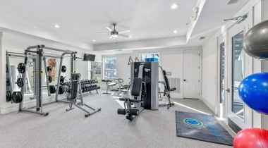 Weights and treadmills at our Ridglea Hills apartment gym