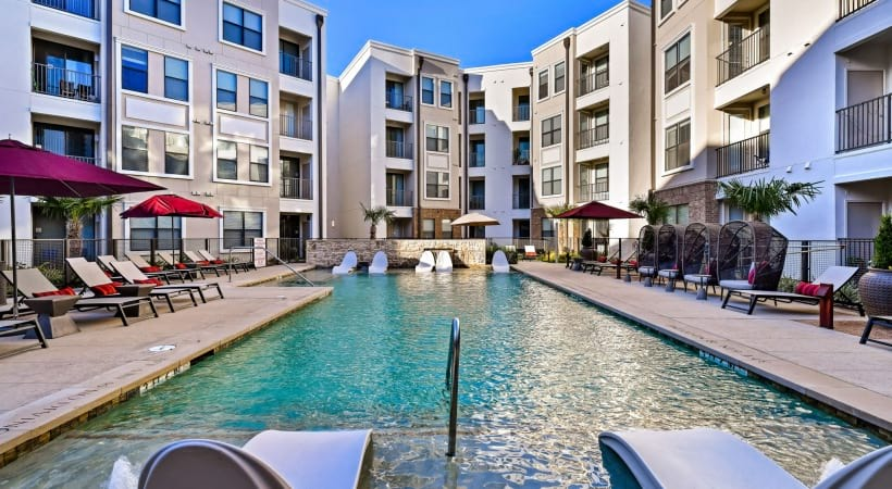 Pool and sun deck at our Stonebriar apartments with pool