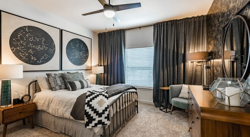 Bedroom with wide windows and 9-foot ceilings at our spacious apartments in Jersey Village