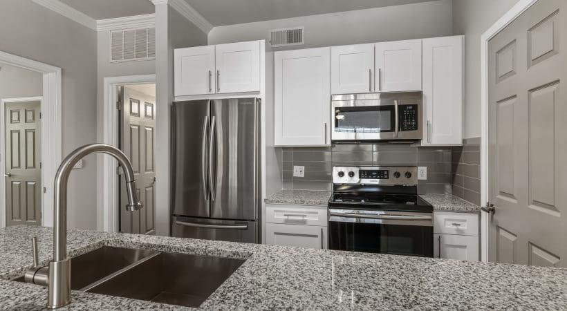 Apartment kitchen with granite countertops