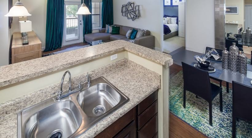 Fossil Creek apartment kitchen with granite countertops