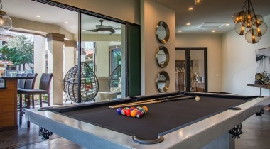 Resident clubhouse with pool table at apartments in Houston