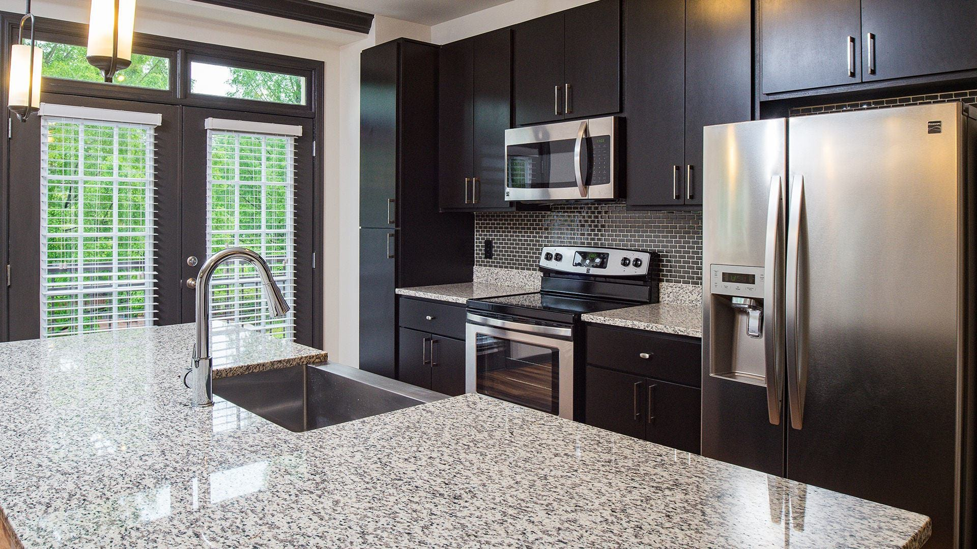 Apartment Kitchen with Sleek Granite Countertops