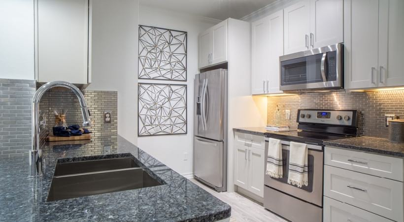 Spacious apartment kitchen with stainless steel appliances
