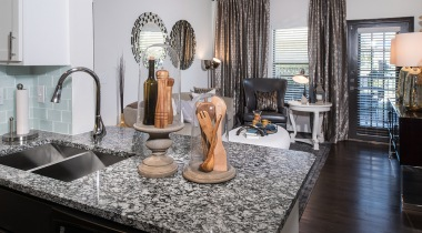 Kitchen with sleek granite countertops at our Westover Hills apartments in San Antonio