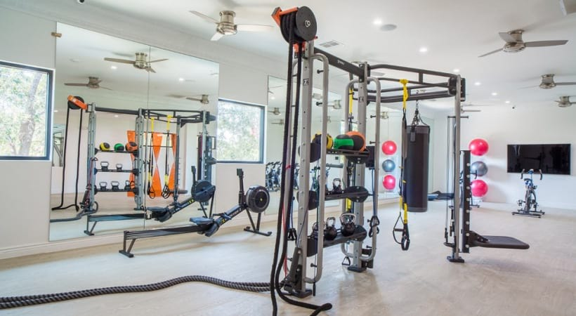 Free weights and other fitness equipments at our upscale apartments for rent in Irving, TX