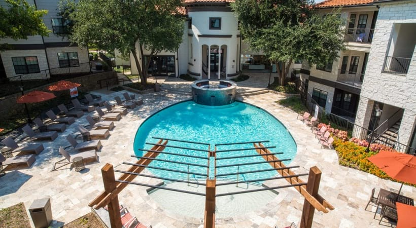 Resort-style pool with sundeck at our Cortland apartments for rent in Irving, TX