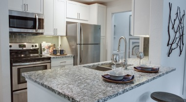 Kitchen breakfast bar with sleek granite countertops