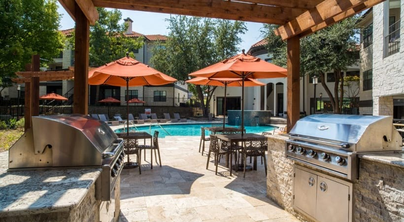 Outdoor gas grills at our Cortland MacArthur apartments for rent in Irving, TX