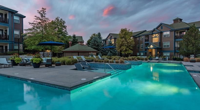 Resort-style pool with night lights at our luxury apartments in Colorado Springs