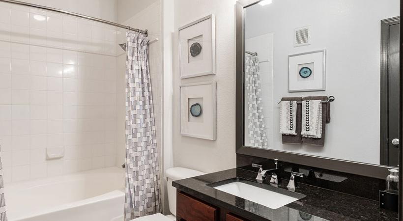 Modern apartment bathroom with deep soaking bathtub