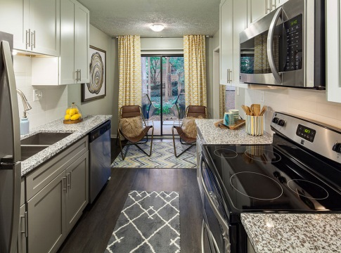 Kitchen with Granite Countertops at Cortland at the Village