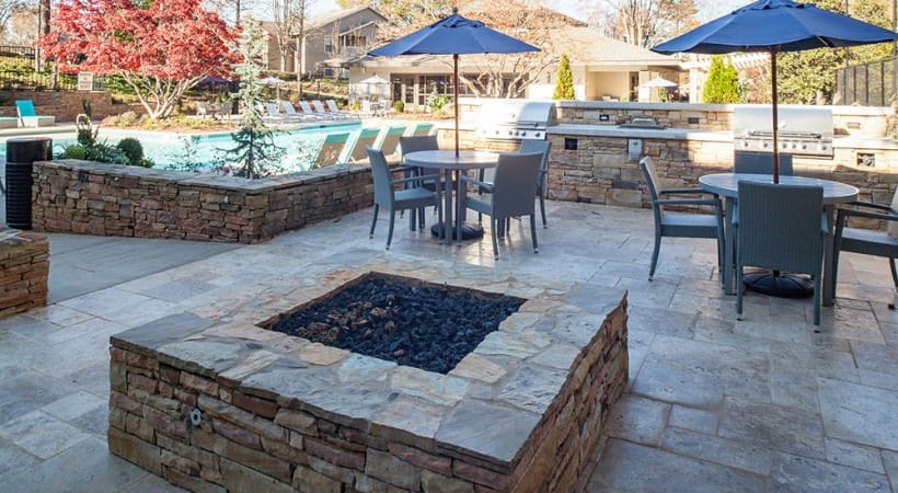 Outdoor fire pit and dining areas at Cortland at the Village
