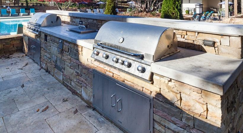 Poolside gas grills at our Lake Village apartments near Cumberland Mall