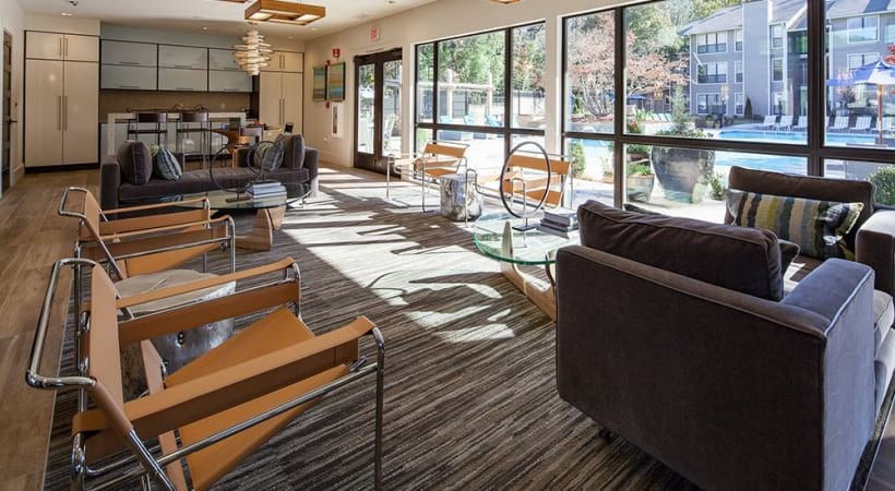 Lounge areas with floor to ceiling windows at our Smyrna apartment clubhouse