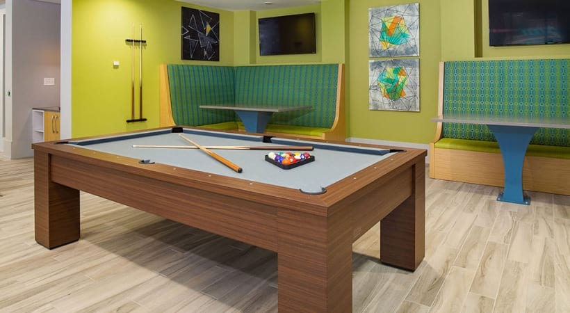 Pool table and HDTVs at our modern apartments in Cobb County