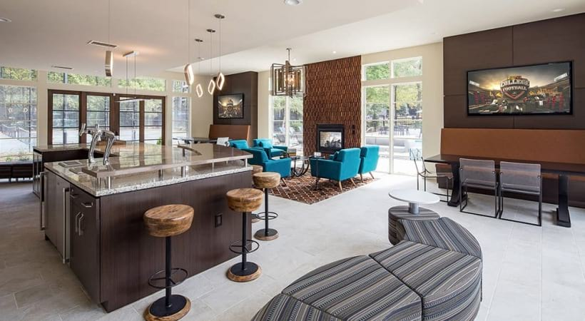Kitchen and HDTVs at Viridian by Cortland's resident clubhouse