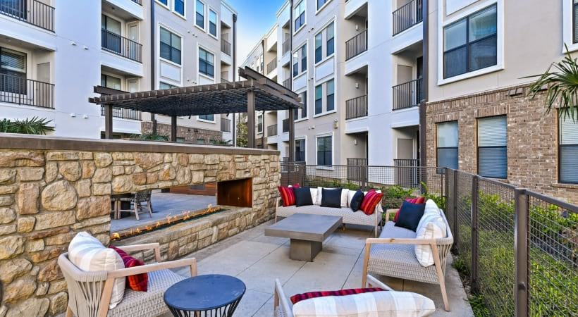 Outdoor lounge area with firepit at our Frisco apartments for rent