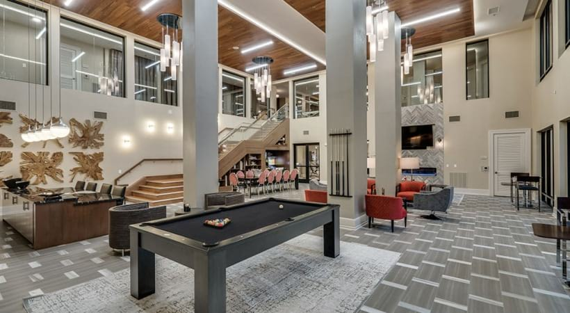 Resident lounge with pool table at apartments in Irving, TX