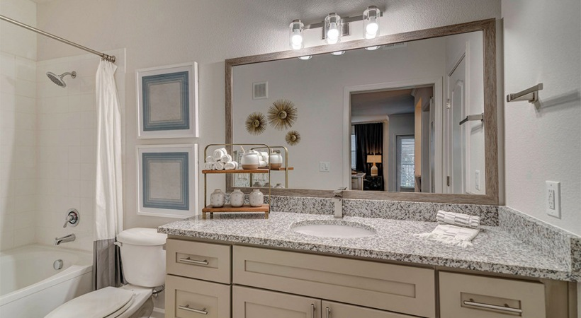 Modern apartment bathroom with granite countertops